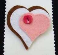 broche corazon rosa